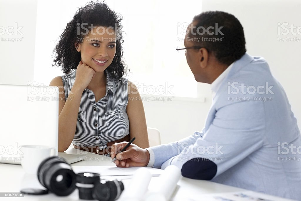 Happy young woman with a photo editor working together royalty-free stock photo