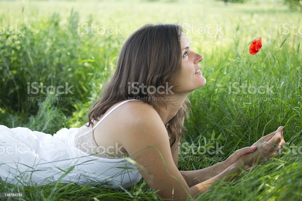 Happy young woman with a poppy royalty-free stock photo