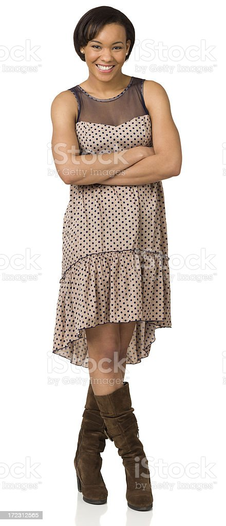 Happy Young Woman With Arms And Legs Crossed royalty-free stock photo