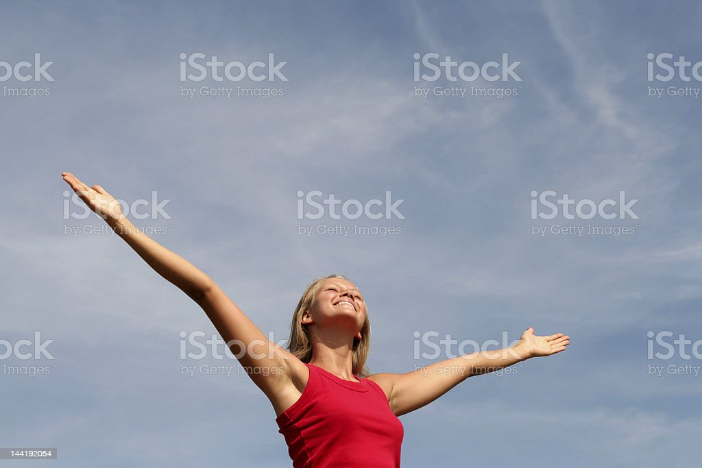 Happy young woman with arms outstretched royalty-free stock photo