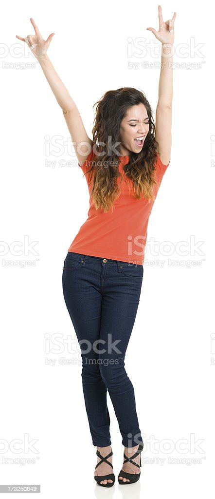 Happy Young Woman With Arms Up stock photo