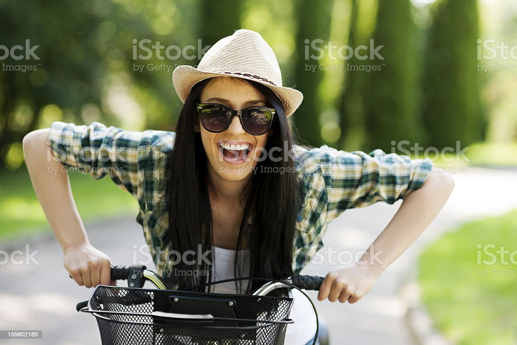 Happy young woman with bicycle royalty-free stock photo