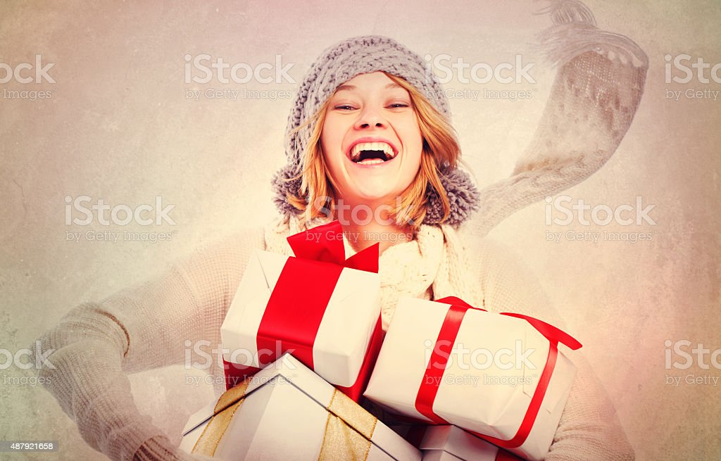 Happy Young Woman with Christmas Gifts stock photo