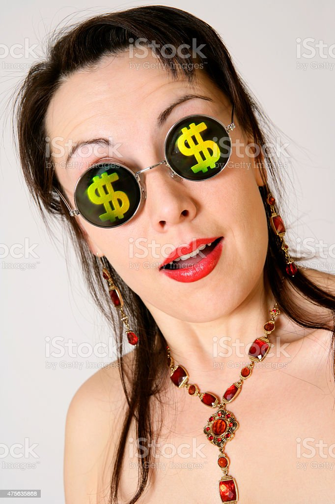 Happy young woman with dollar signs at her glasses stock photo