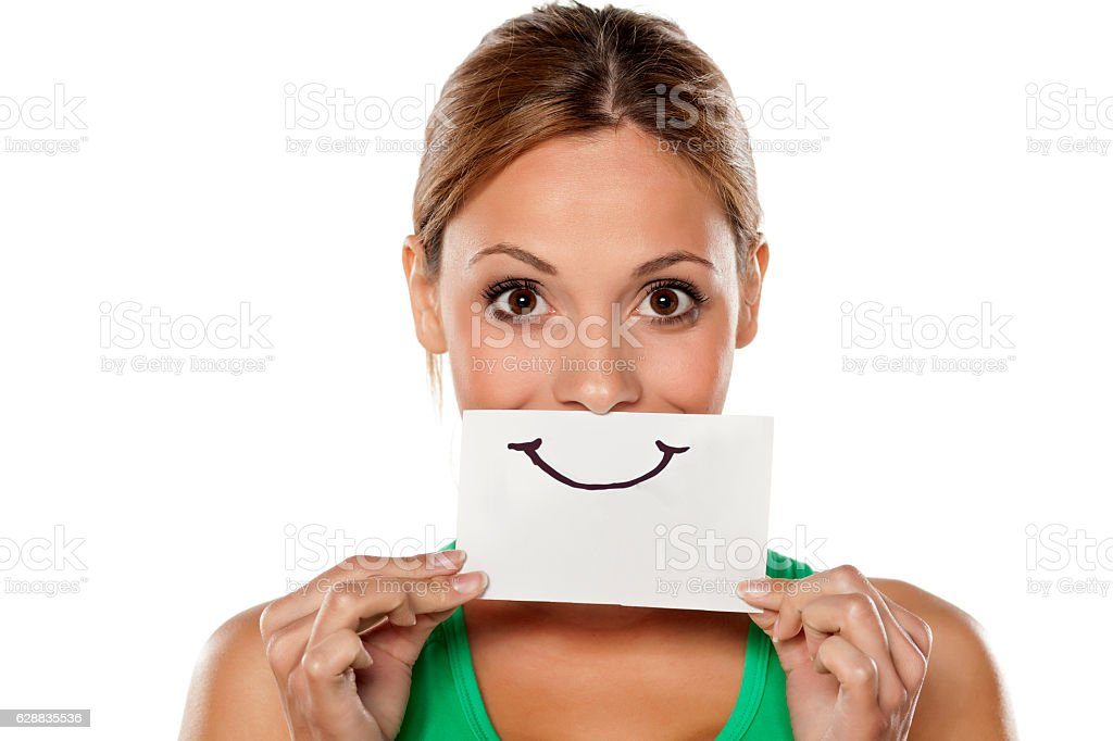 happy young woman with emotions drawn on a piece of stock photo