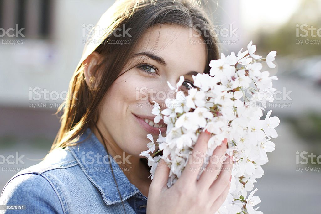 Happy young woman with flower royalty-free stock photo