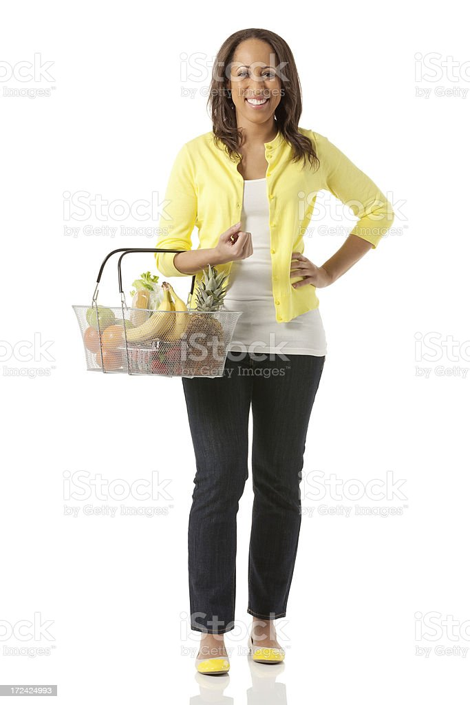 Happy young woman with fruit basket royalty-free stock photo