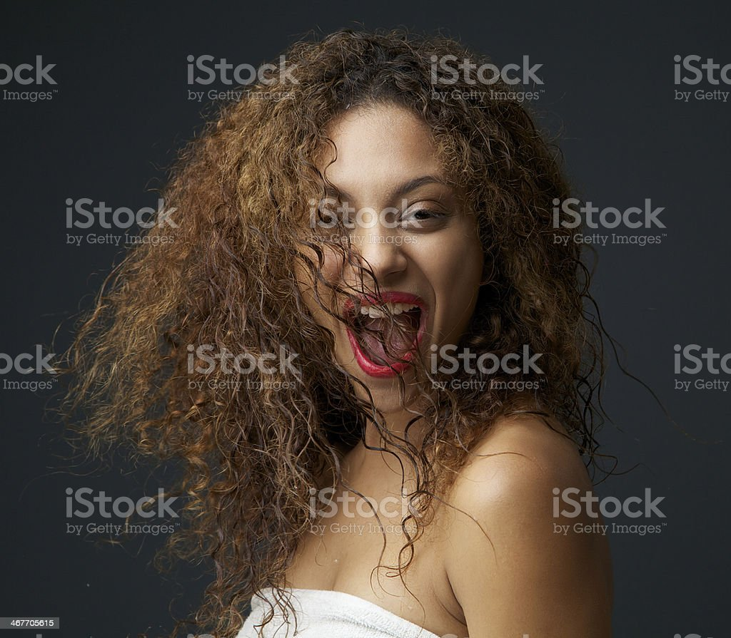 Happy young woman with fun expression on face royalty-free stock photo