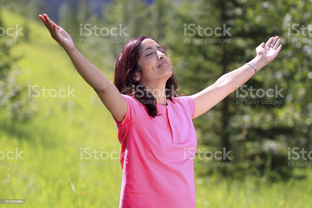 Happy young woman with her arms wide open royalty-free stock photo
