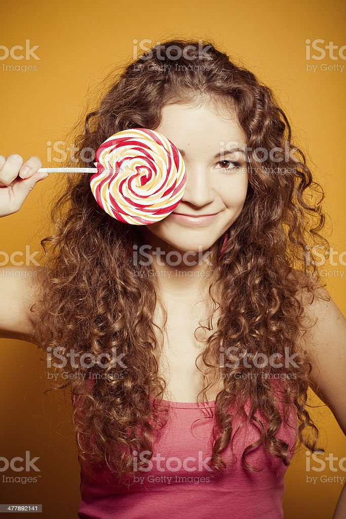 happy young woman with lollipop royalty-free stock photo