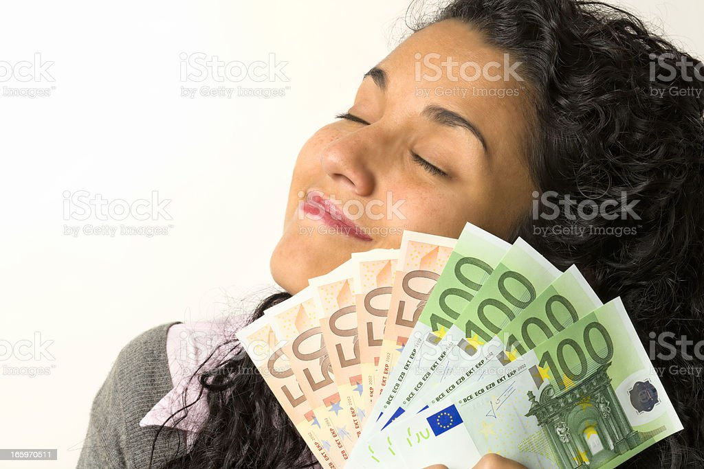 Happy young woman with money in hands stock photo