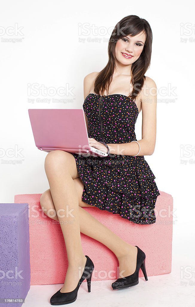 Happy young woman with pink netbook royalty-free stock photo