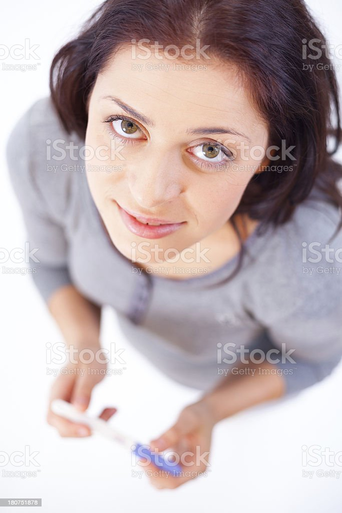 Happy young woman with pregnancy test indoors royalty-free stock photo