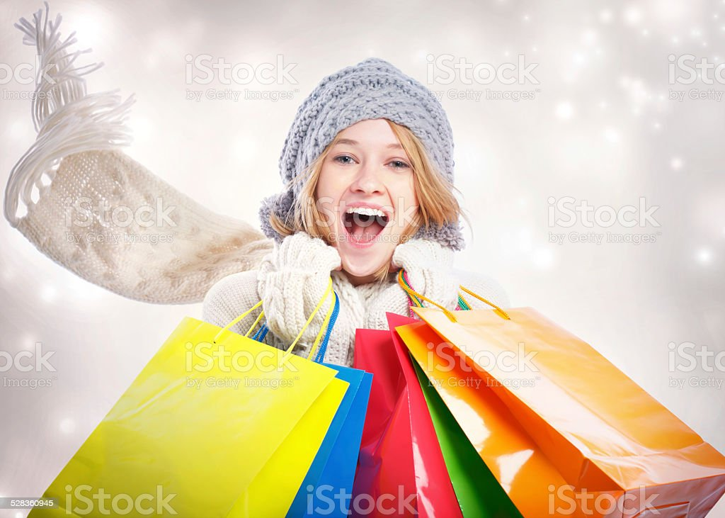 Happy Young Woman with Shopping Bag stock photo