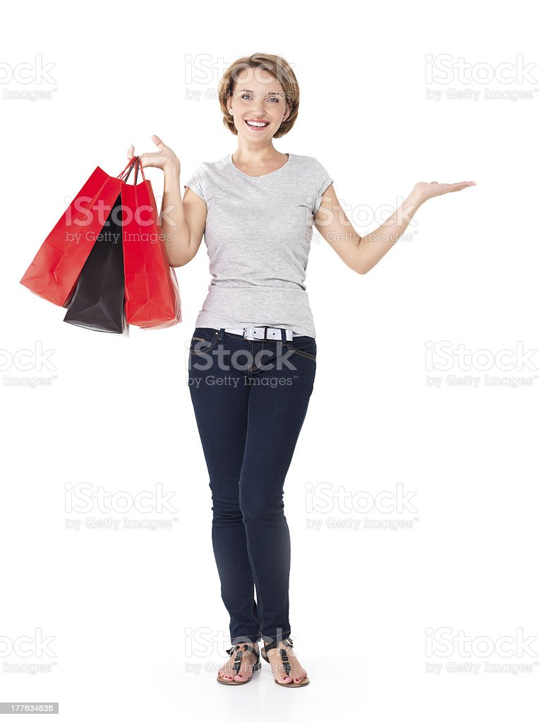 Happy young woman with shopping bags royalty-free stock photo