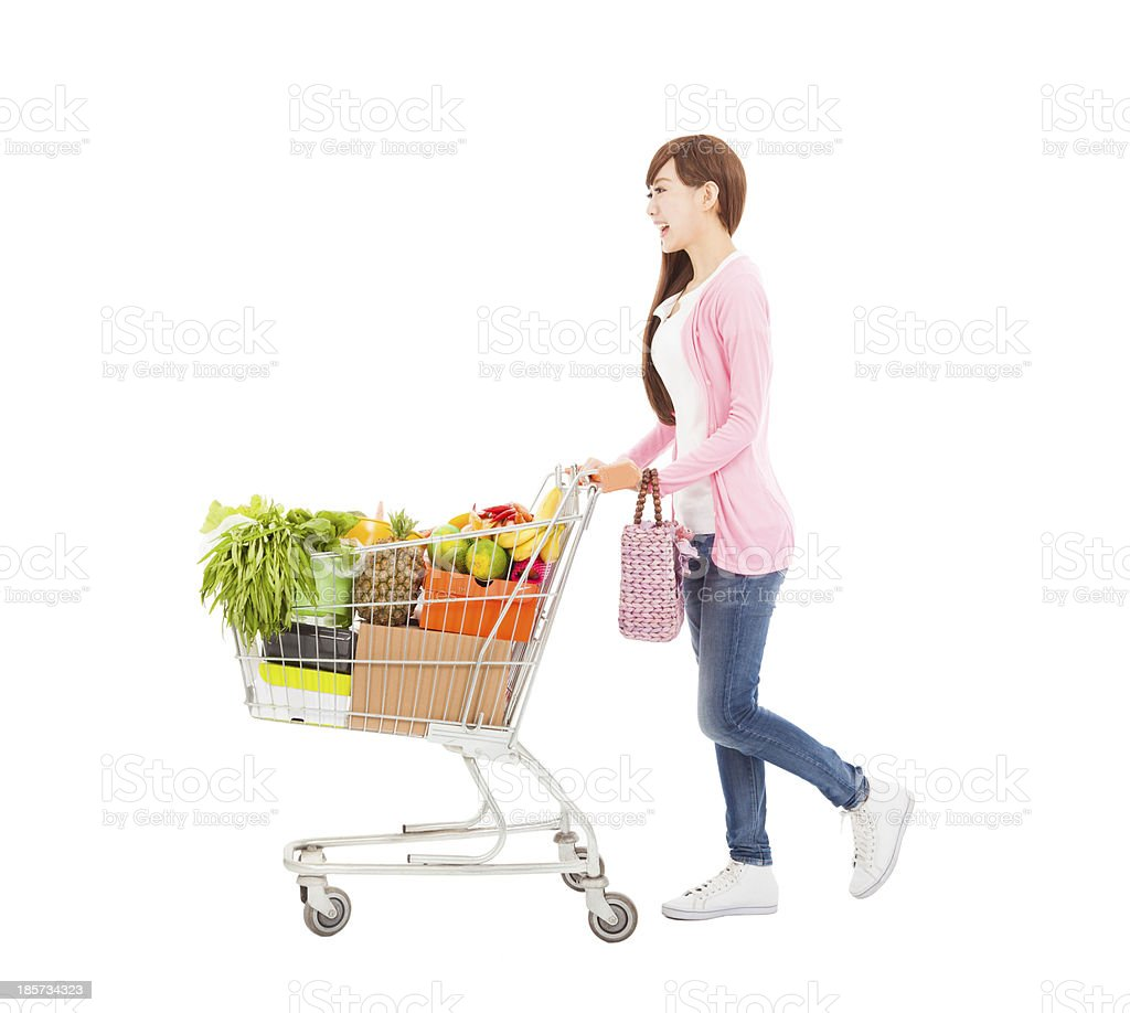 happy young woman with  shopping cart royalty-free stock photo