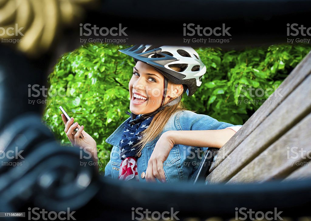 Happy young woman with smart phone royalty-free stock photo