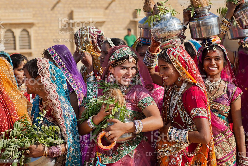 Happy young women dressed in traditional indian sari stock photo