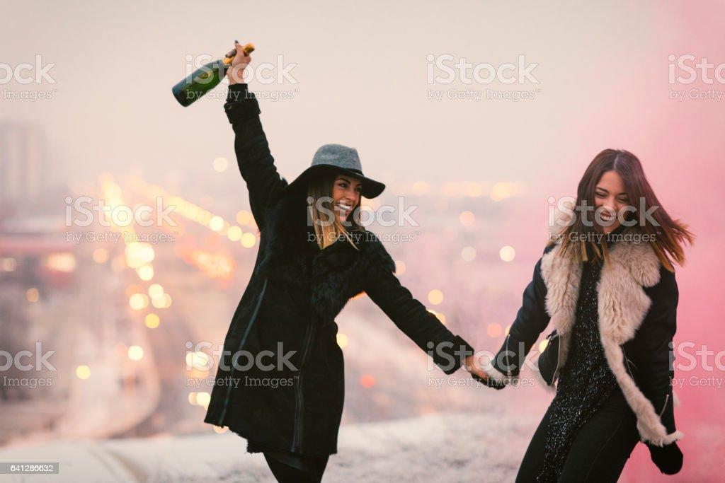 Happy Young Women Having Fun With smoke bomb stock photo