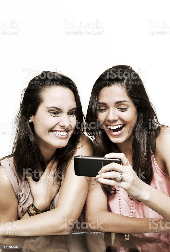 Happy young women in front of the smartphone royalty-free stock photo