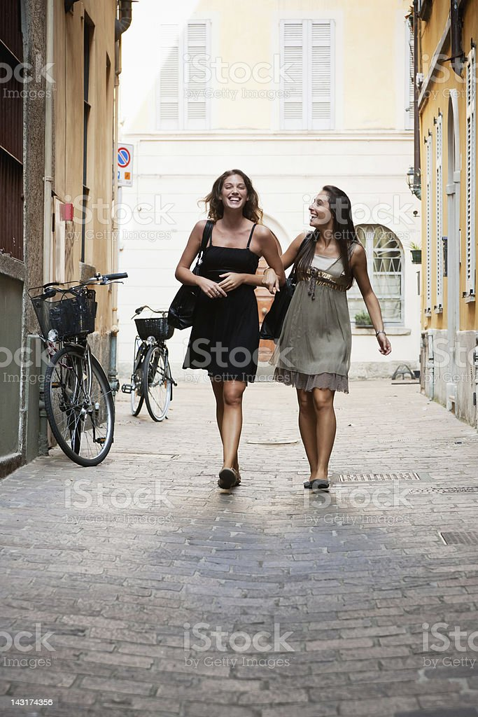 Happy Young Women on Shopping Tour in Streets of Italy stock photo