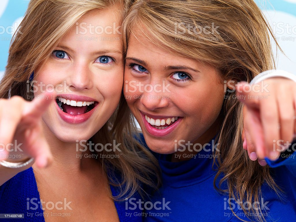 Happy young women pointing fingers royalty-free stock photo
