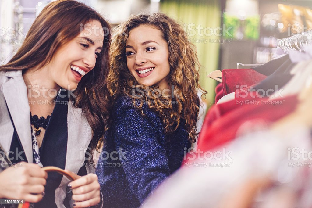 Happy young women shopping clothes stock photo