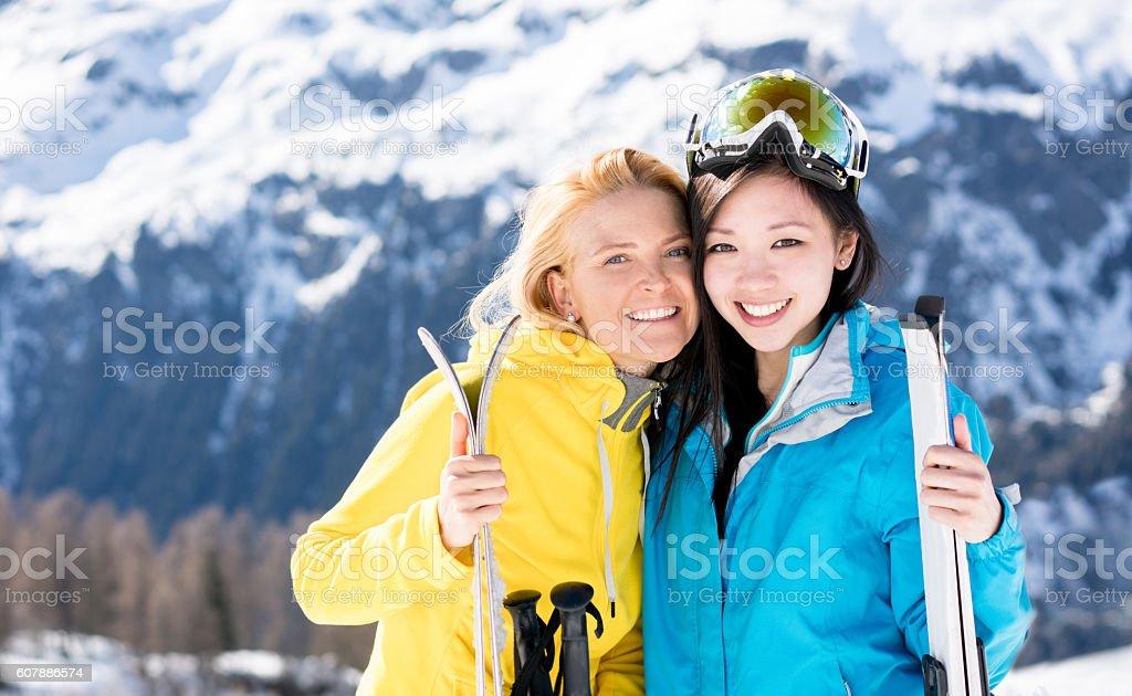 Happy young women skiing stock photo