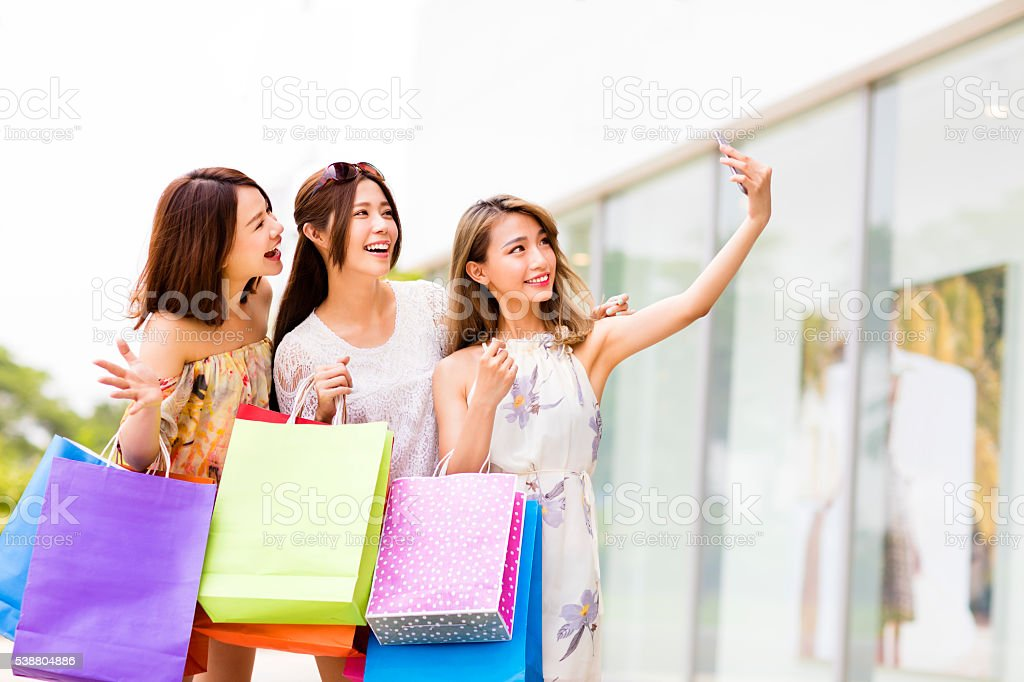 happy young Women Taking  Selfie while Shopping stock photo