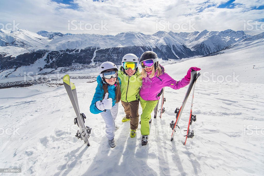 Happy youth in colorful jackets ski alps resort stock photo