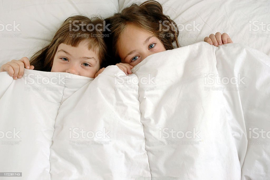 Hapy children in bed royalty-free stock photo