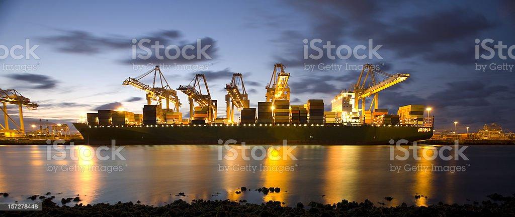 Harbor activity at dusk royalty-free stock photo