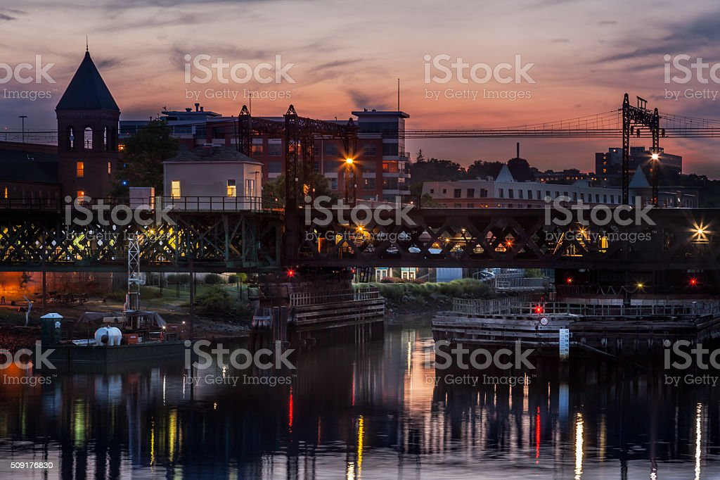 Harbor At Sunset with Boats and Bridge stock photo