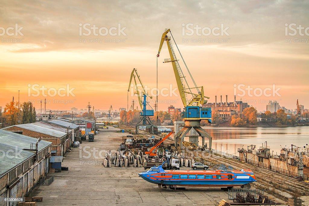 Harbor cranes at sunset stock photo