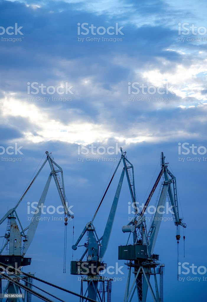 Harbor Cranes in Evening Light stock photo
