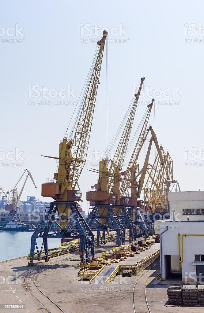 Harbor cranes in sea cargo port stock photo