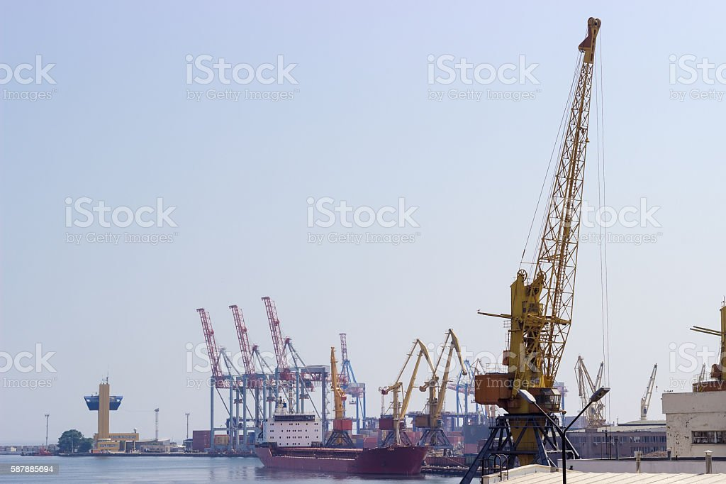 Harbor cranes in seaport stock photo
