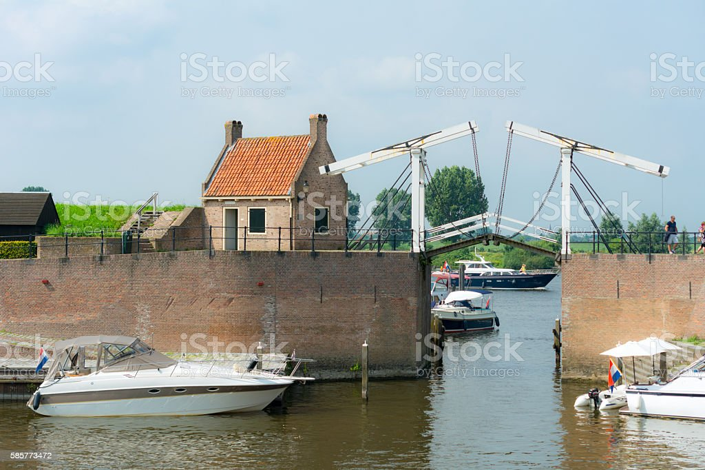 Harbor entance  fortified city wall Heusen Netherlands stock photo