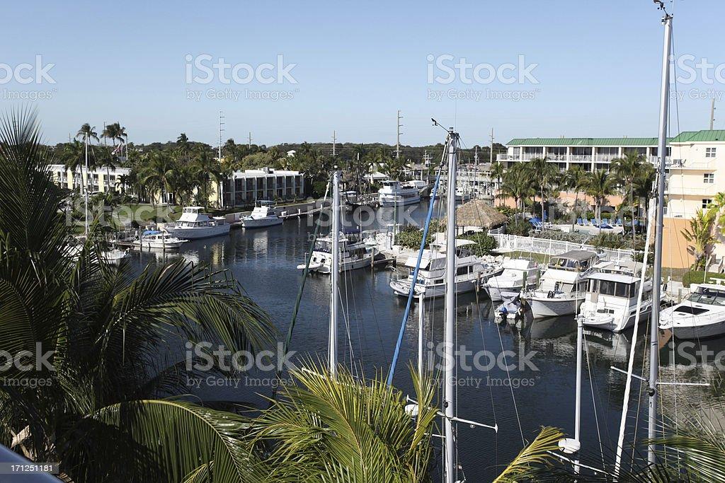 Harbor marina on Key Largo, Florida.  Yachts.  Copy space.  Horizontal. stock photo