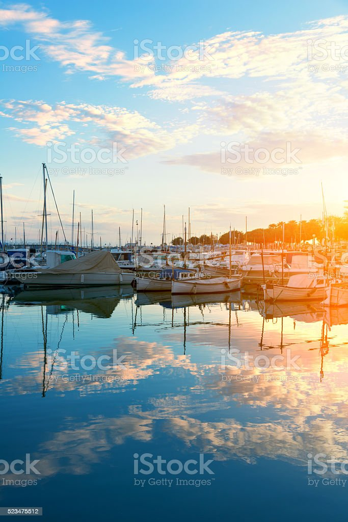 Harbor of Palma de Mallorca in sunset with cloud mirroring stock photo