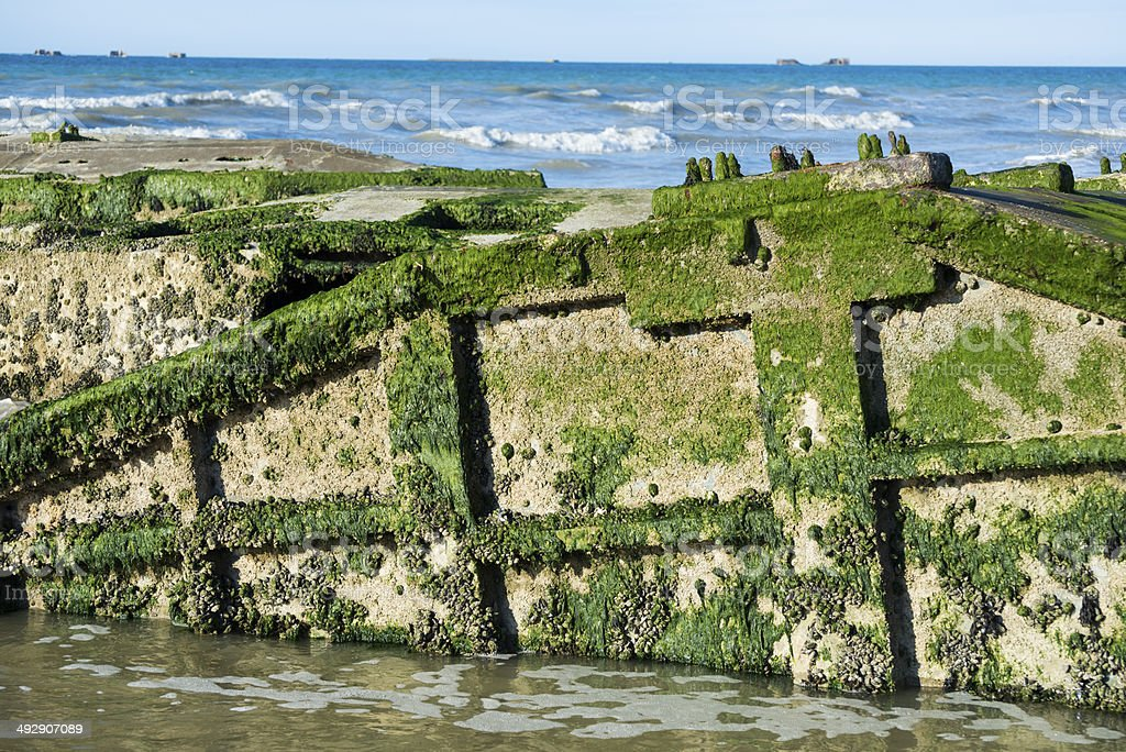 WWII harbor remains in Arromanches, France stock photo