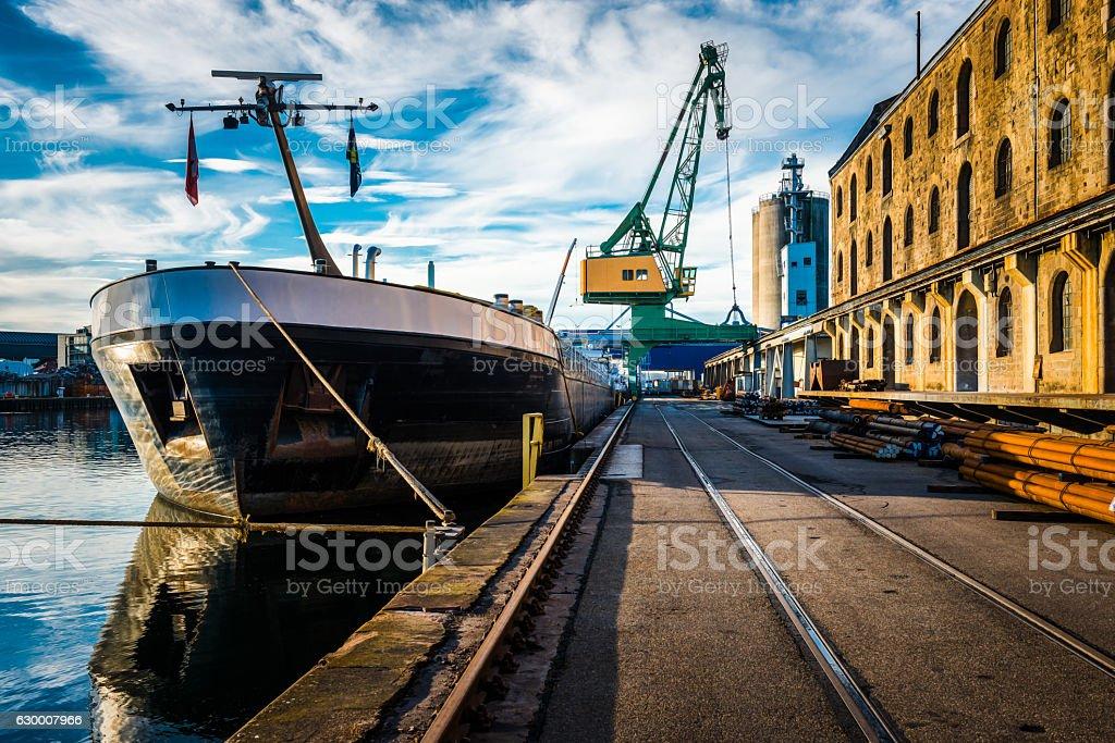 harbor scene with ship and crane stock photo