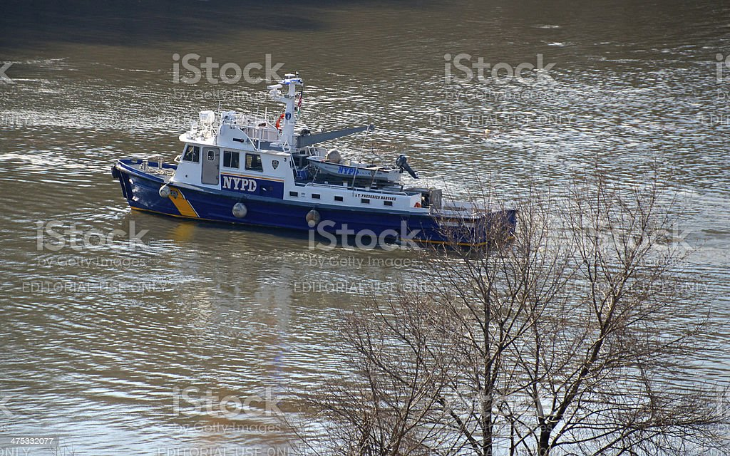 NYPD Harbor Unit Boat on Harlem River Ship Canal, NYC stock photo