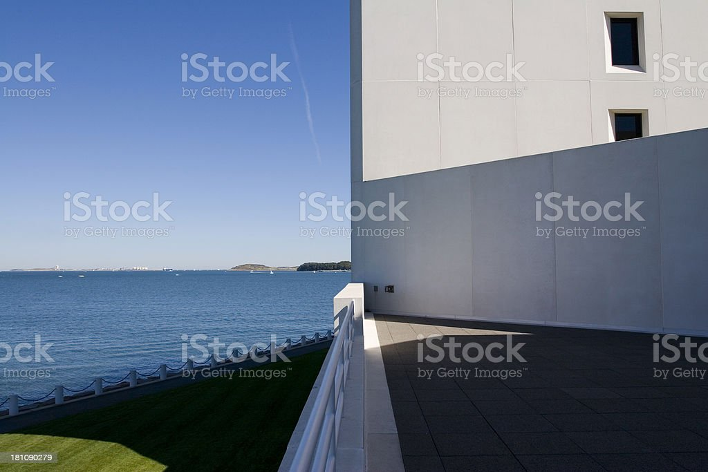 Harbor view beyond building, JFK library, abstract composition royalty-free stock photo