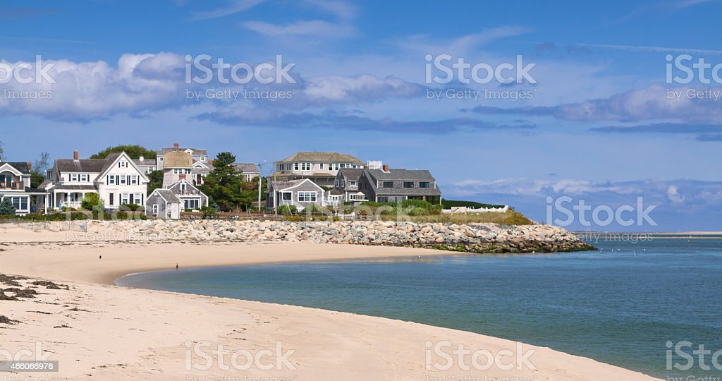 Harbor view, Cape Cod seashore with white sand beach & homes stock photo