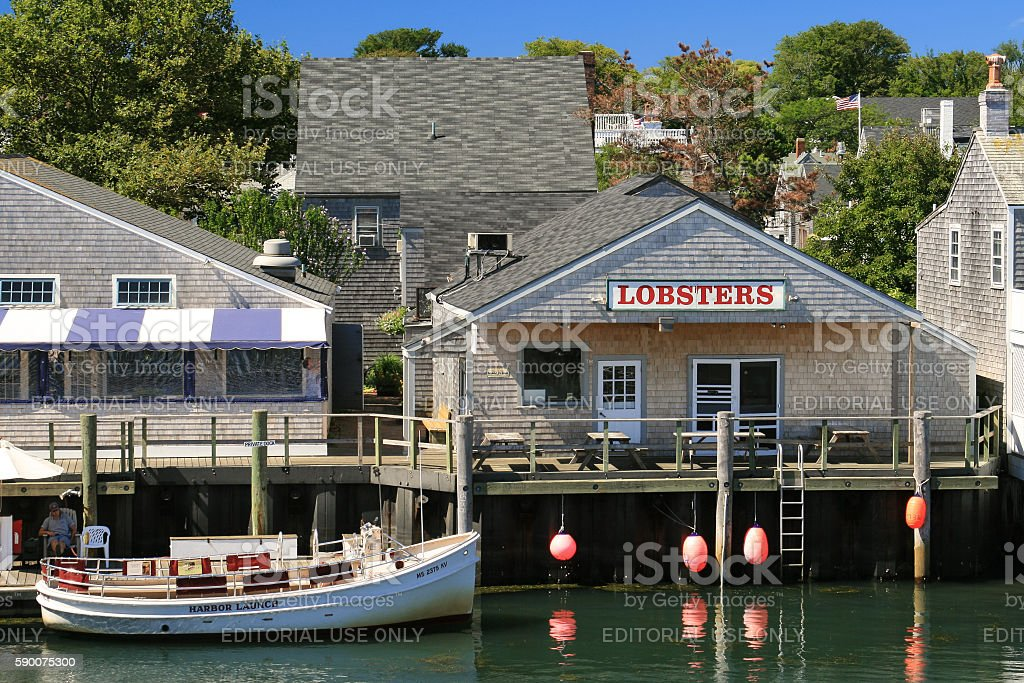 Harbor View, Lobster Restaraunt and Moored Boat, Nantucket Island, Massachusetts. stock photo