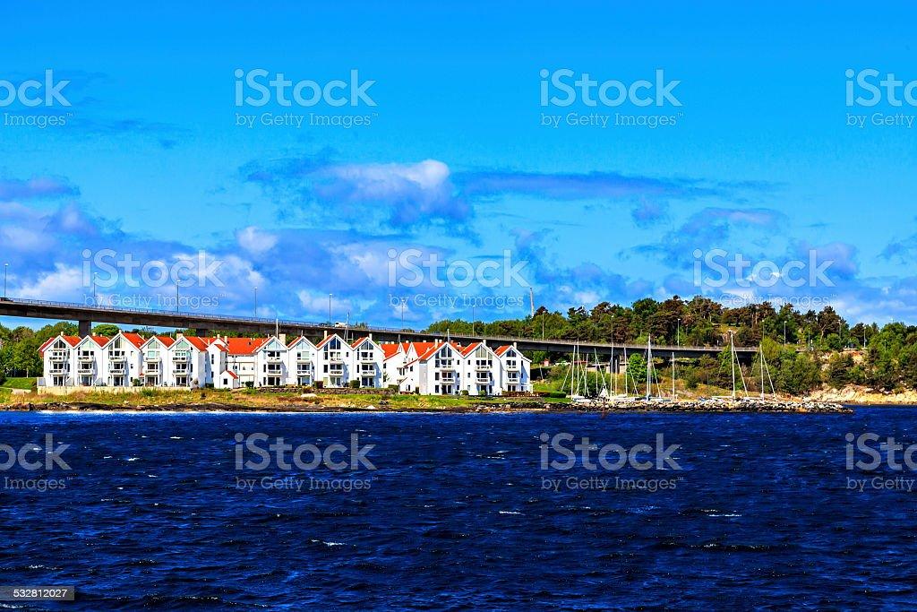 Harbor, white houses and bridge, Norway stock photo