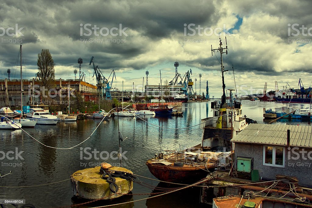 harbor with boats and cargo ships stock photo