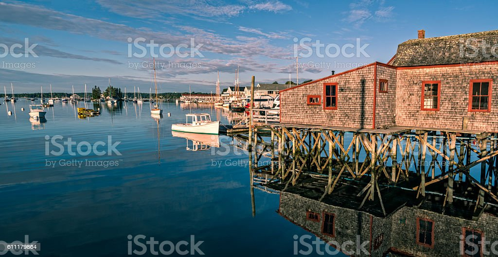 Harbor with rustic fishing shack and pier in Maine stock photo