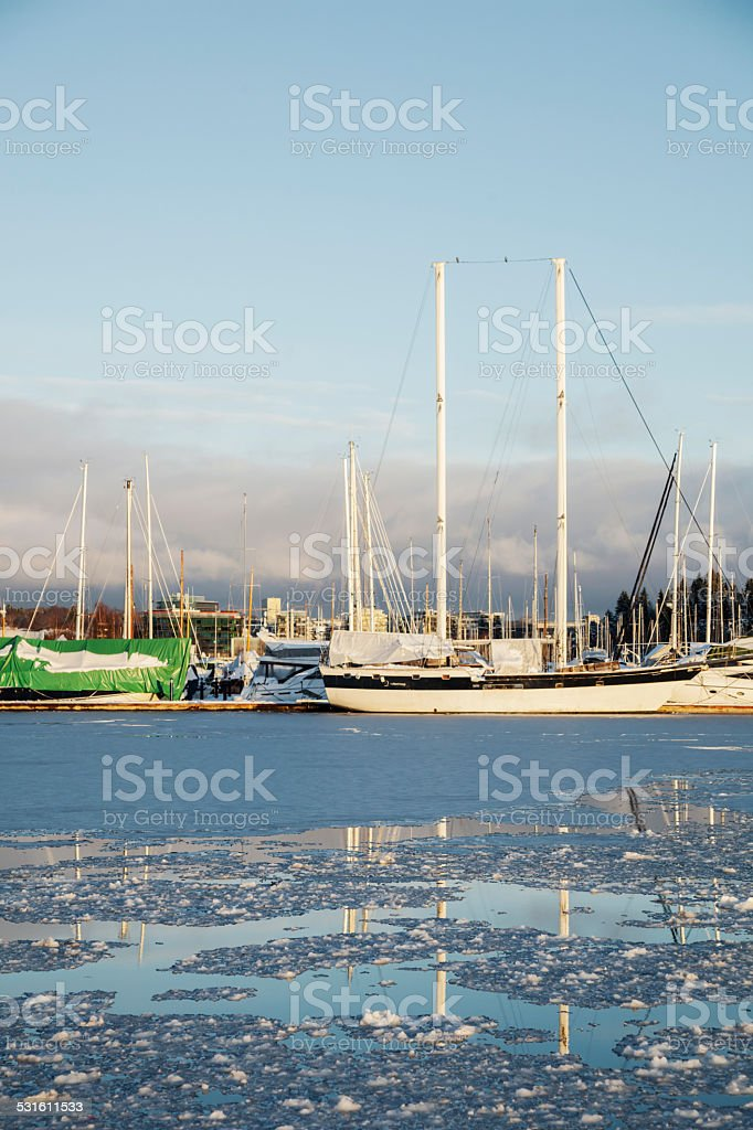 Harbor with sail boats at sunset. stock photo